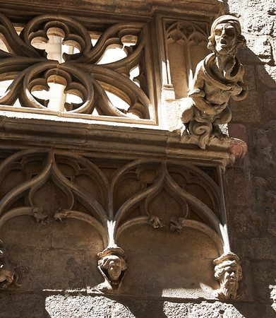 Medieval sculpture adornes the wall of an alley in the Gothic Quarter, Barcelona