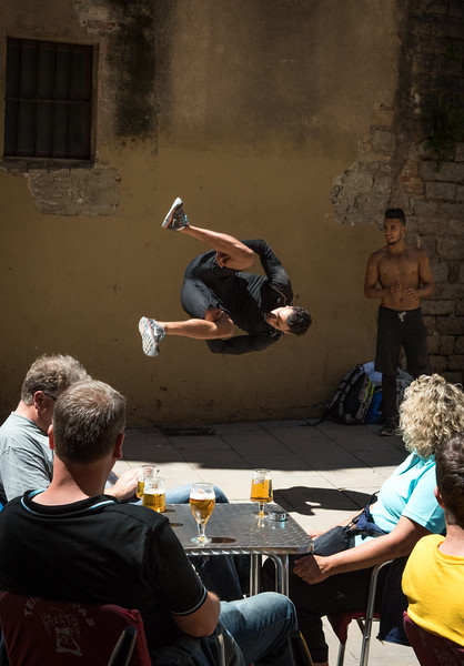 Street performer doing a somersalt in front of a crowd , Barcelona