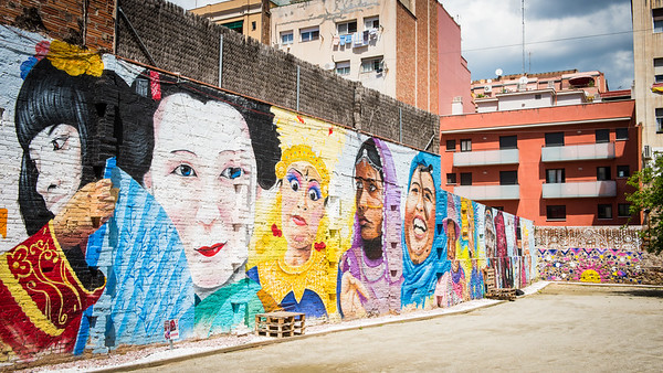 Colourful mural depicting people of different cultures, Barcelona