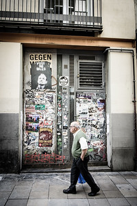 Walking past a defaced door | Barcelona