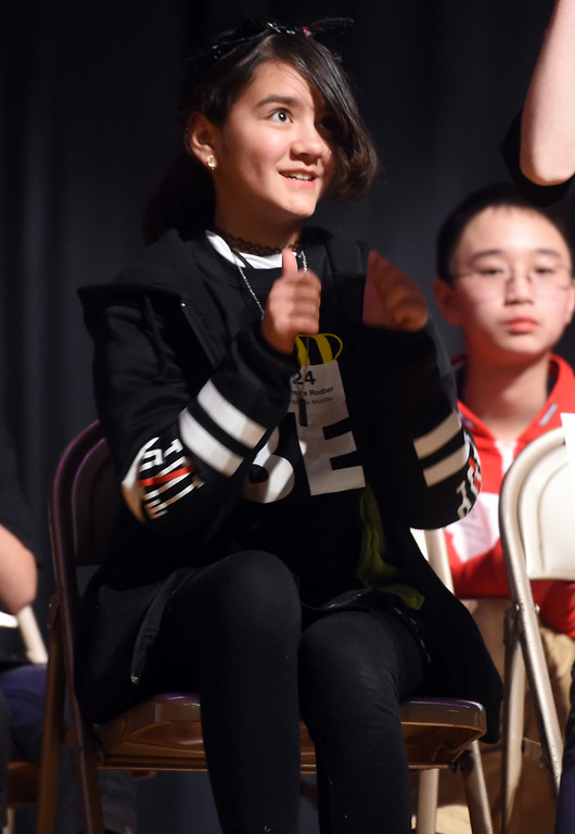 . Annetta Rodier, a 7th-grader, reacts to a friend getting a word correct during the Barnes & Noble Regional Bee Speller  at Platt Middle School.  Cliff Grassmick / Staff Photographer/ February 10, 2018