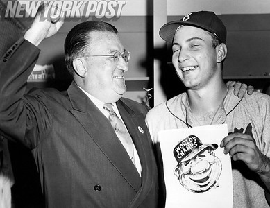 Walter O'Malley cheers his ace World Series pitcher, Johnny Podres. 1955