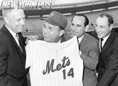 Mets President Bing Devine and Manager Gil Hodges display baseball shirt. 1967