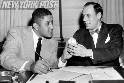 Buzzie Bavasi  signs Don Newcombe to his new contract with the Dodgers. 1951