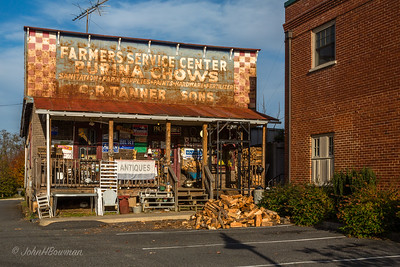 Ruth Ann & I met Tim Carrier at Zion Crossroads for photo session in Louisa, Orange, & Madison counties; Old feed store with weathered signs and very full porch sits across S Main St (Bus US 29) from old Madison County courthouse & across Church St from newer district court building