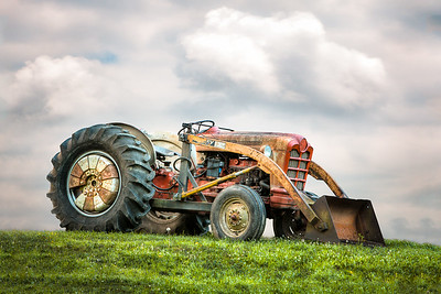 ford powermaster tractor on a hill