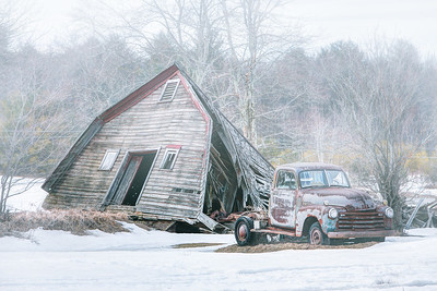 Collapsed barn and old truck