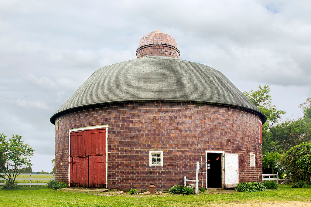 1917 Round clay tile barn with clay tile silo in center.