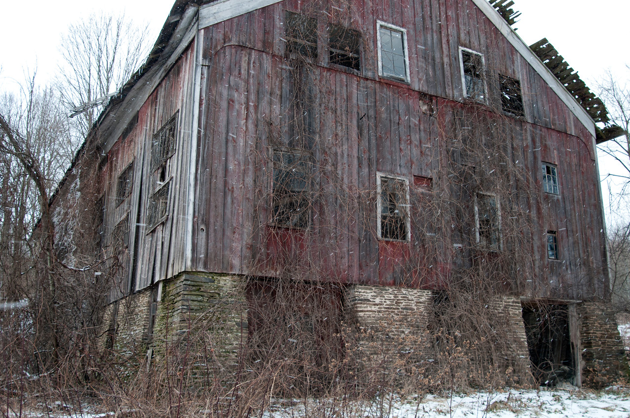 This barn located just north of the Village of Sherburne, NY is on it's last legs, yet take a close look at the foundation.  It is a work of art.