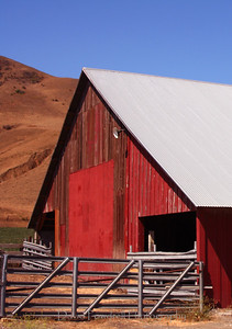 Red barn on a blue day.