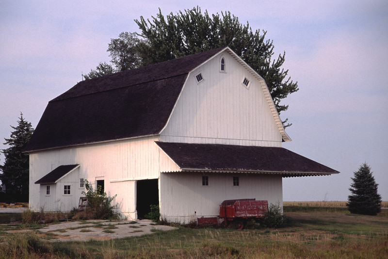 This barn, with Dutch Gambrel roof, was built in 1927. Used as a dairy barn, there is a small milke house on the west side attached to the barn.The builder's signature, tipped windows, are on the upper part of the gable end. This barn stands on land that has always been in the family.
