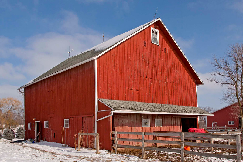 New England style barn built in 1910. The barn was built with lumber from barn site. It has haymow door on one gable end and protecting overhang on the south facing gable end. Lower lower level, with wooden partitions is used for horses.