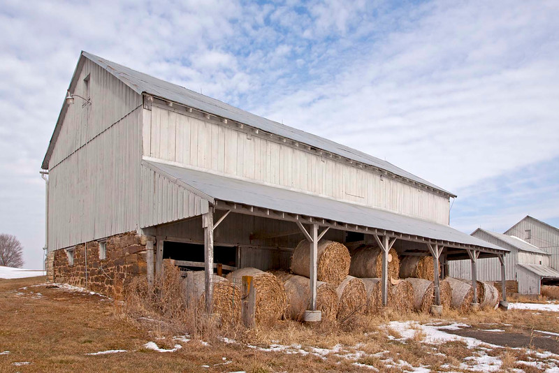 This horse barn in West Amana was built in 1886 and is 130 x 46 feet. Limestone foundation. <br /> Bank barn on North side. An overhang on south side for lower level protection from the weather.