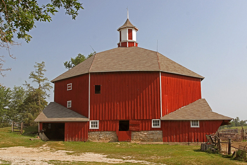 Octagon Barn. Built in 1883 on a foundation of locally quarried stone 14 to 16 inches thick. The barn is two stories high and each one of the eight sides is 26' long. The barn is 61 feet in diameter. The land has been in the Roberts family since the Civil War when John E. Roberts settled in the area. The barn is on the National Registry of Historical Places. It is still a working barn.