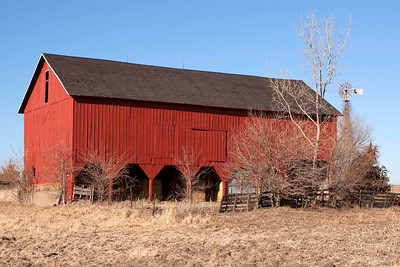 Sleichter Barn; One of the oldest (1880) in Johnson County. This barn is a classic Pennsylvania style bank barn with posted bays opposite the ramp to the secound floor. Lumber used in building the barn was barged down the Mississippi River to a sawmill in Muscatine.It was hauled 30 miles from Muscatine to the barn site by wagons pulled with horses.The original brown sandstone foundation was probably quarried locally. The barn is now used for hay storage.