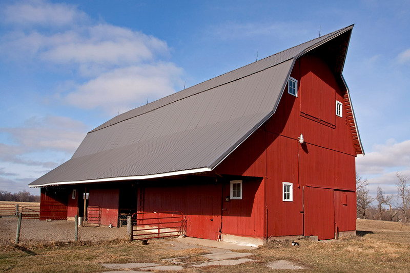 Barn was built 1940 with native oak lumber from the barn site. Beams are pegged mortise and tenons. The barn has a Dutch style Gambrel roof with southern exposure over hanging roof line for weather protection to animals and to the doors into the lower level.<br /> The extended gable peak is for mounting the hayfork track and getting hay thru the hay door into the haymow. The barn is used for horses.
