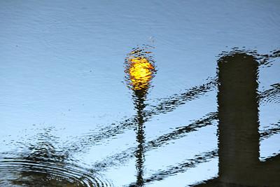 February 28, 2013. Reflected lamp post.