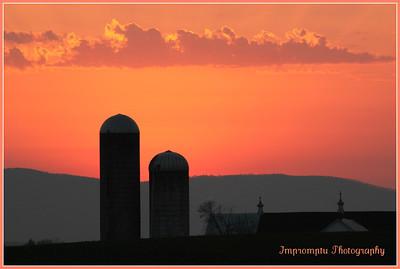 * July 21, 2011. Barn and silos at sunset, Mason Dixon line. MD and PA