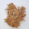 Seneca miniature corn husk mask given to Charles Bartlett by Jesse Cornplanter.