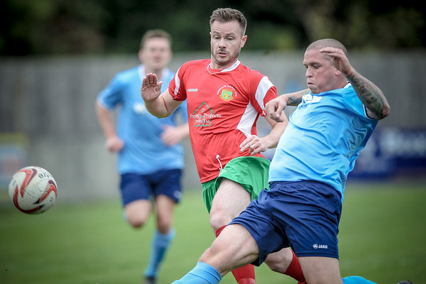 Stephen Bromley beaten to the ball by the Barton Town defender