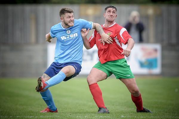 Paul Beesley fights for position before the header.