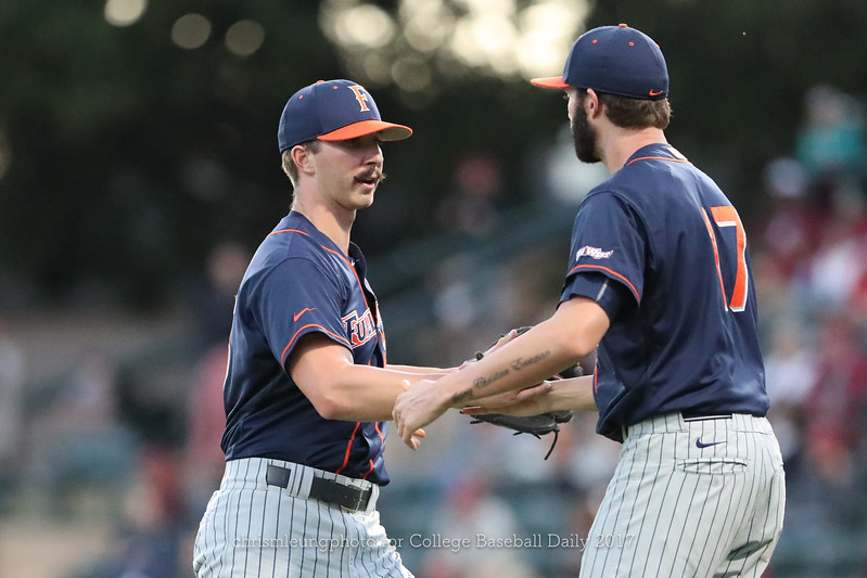 6/3/17: NCAA Regionals Stanford vs Fullerton at Klein Field at Sunken Diamond in Palo Alto, CA <br /> CSU Fullerton Titans pitcher Blake Workman (55)<br /> CSU Fullerton Titans pitcher Colton Eastman (17)<br /> <br /> Image by Chris M. Leung for College Baseball Daily