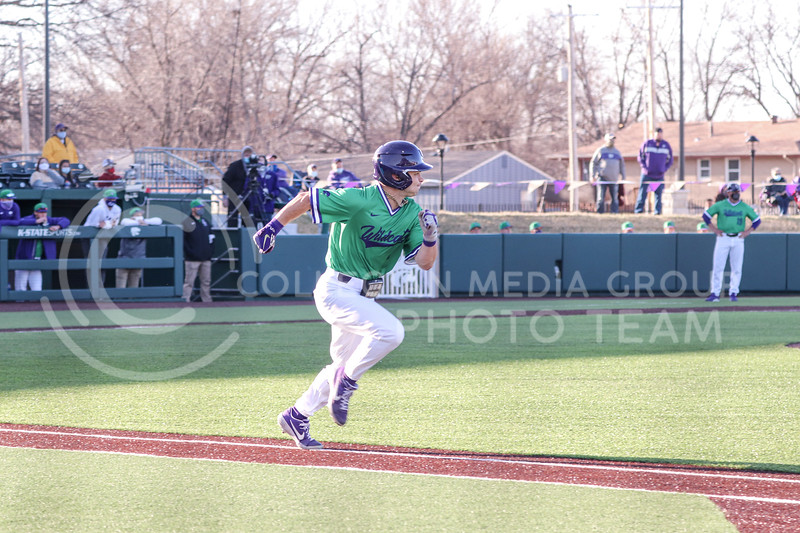 Freshman Dom Hughes approaches first base during the game on March 19, 2021 against New Mexico. (Macey Franko | Collegian Media Group)