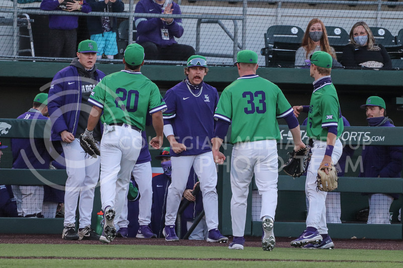 Sophomores Daniel Carinci and Jordan Wicks return to the dugout during the game on March 19, 2021 against New Mexico. (Macey Franko | Collegian Media Group)
