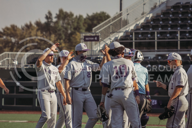 The grey team celebrates a win after the first game of the intrasquad Fall World Series at Tointon Family Stadium on October 8th. (Sophie Osborn | Collegian Media Group)