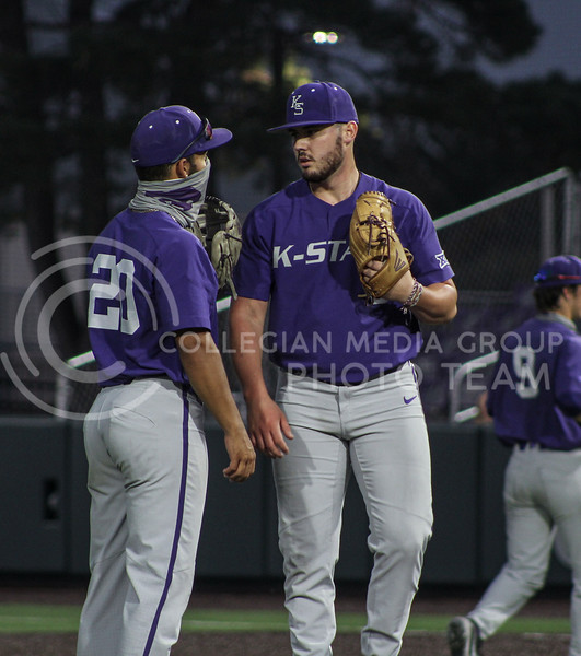 Jaxon Passino talks to teammate Daniel Carinci after a pitching change in game two of the team's Fall World Series at Tointon Family Stadium on October 9th. (Macey Franko | Collegian Media Group)