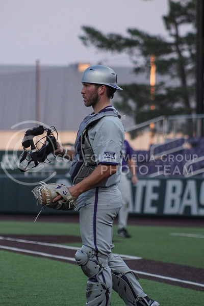 Austin Garrett surveys the field while preparing for the next inning of game two of the team's Fall World Series at Tointon Family Stadium on October 9th. (Macey Franko | Collegian Media Group)