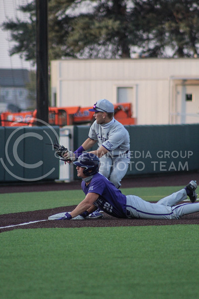 Zach Kokoska slides into third base trying to avoid the third baseman Elijah Dale during game two of the team's Fall World Series at Tointon Family Stadium on October 9th. (Macey Franko | Collegian Media Group)
