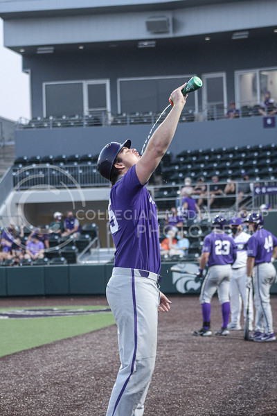 Carson Seymour sprays water into his mouth in between innings of game two of the team's Fall World Series at Tointon Family Stadium on October 9th. (Macey Franko | Collegian Media Group)