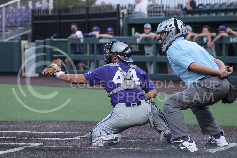 Dylan Caplinger catches a strike in game two of the team's Fall World Series at Tointon Family Stadium on October 9th. (Macey Franko | Collegian Media Group)