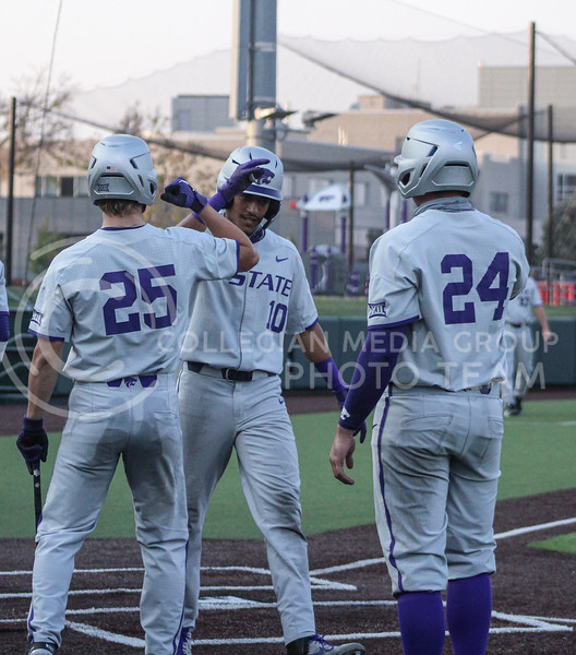 Kamron Willman celebrates with teammates Nick Goodwin (left) and Dylan Phillips (right) after scoring a run in Game two of the team's Fall World Series at Tointon Family Stadium on October 9th. (Macey Franko | Collegian Media Group)