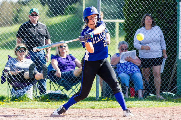 Record-Eagle/Brett A. Sommers Kalkaska's Makenzie Wilkinson swings at the ball during Thursday's game against Traverse City West. West won the opener 3-1.