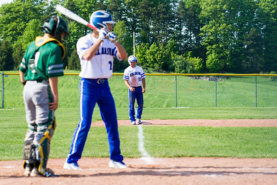 Record-Eagle/Brett A. Sommers Kalkaska's Rafael Palma eyes the pitcher from the third-base line during Thursday's game against Traverse City West. West won the doubleheader opener 15-5.