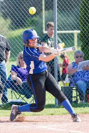 Record-Eagle/Brett A. Sommers Kalkaska's Angela Iott fouls the ball off her bat during Thursday's game against Traverse City West. West won the opener 3-1.