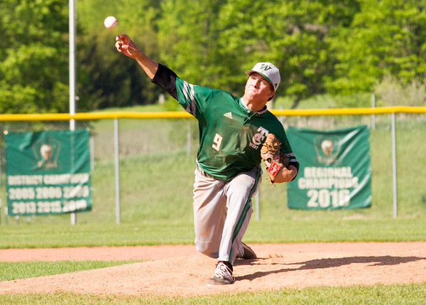 Record-Eagle/Brett A. Sommers Traverse City West's Sam DeKuiper pitches during Thursday's game against Kalkaska. West won the doubleheader opener 15-5.