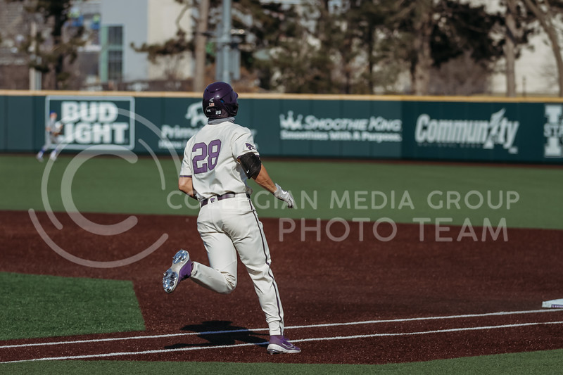 Junior Zach Kokoska heads to first base during the first game against Eastern Illinois on March 5, 2021 at Tointon Family Stadium. (Sophie Osborn | Collegian Media Group)