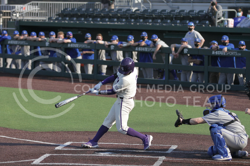 Senior Cameron Thompson swings for the ball during the first game against Eastern Illinois on March 5, 2021 at Tointon Family Stadium. (Sophie Osborn | Collegian Media Group)