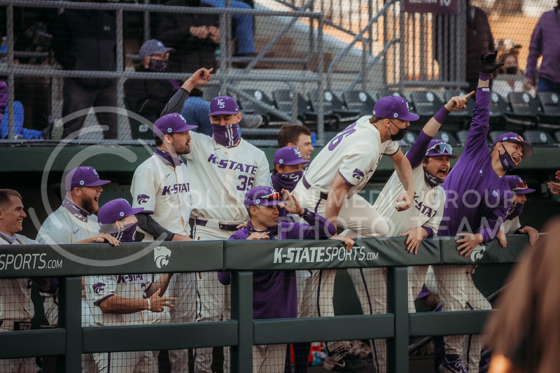 Players in the dugout celebrate a successful run during the first game against Eastern Illinois on March 5, 2021 at Tointon Family Stadium. (Sophie Osborn | Collegian Media Group)