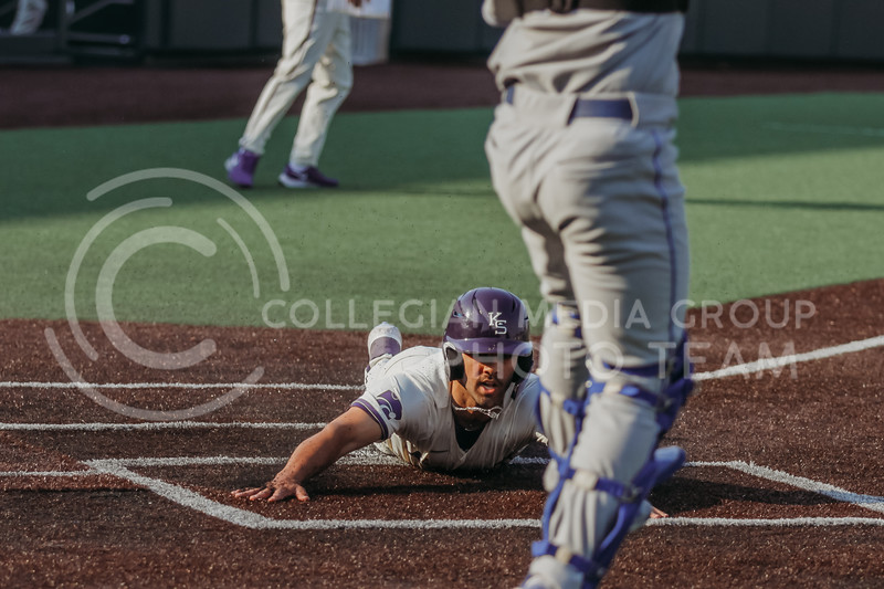 Sophomore infielder Daniel Carinci slides into home plate during the first game against Eastern Illinois on March 5, 2021 at Tointon Family Stadium. (Sophie Osborn | Collegian Media Group)
