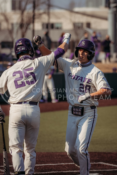 Teammates celebrate a run during the first game against Eastern Illinois on March 5, 2021 at Tointon Family Stadium. (Sophie Osborn | Collegian Media Group)