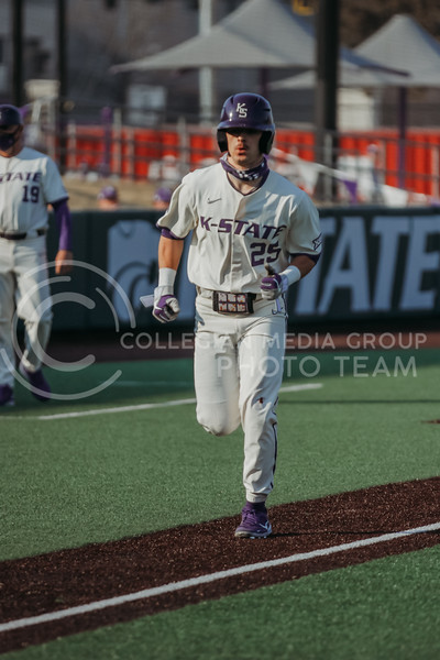 Freshman Nick Goodwin looks to make it home during the first game against Eastern Illinois on March 5, 2021 at Tointon Family Stadium. (Sophie Osborn | Collegian Media Group)