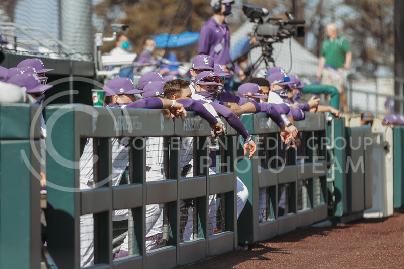 Players in the dugout watch during the the March 7, 2021 game against Eastern Illinois. (Sophie Osborn   Collegian Media Group)