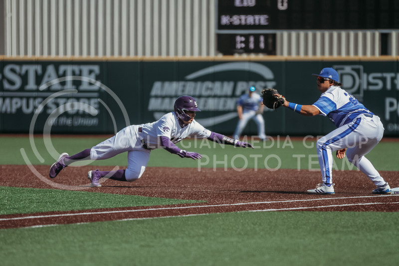 dives towards the base in an attempt to not get tagged out during the the March 7, 2021 game against Eastern Illinois. (Sophie Osborn   Collegian Media Group)