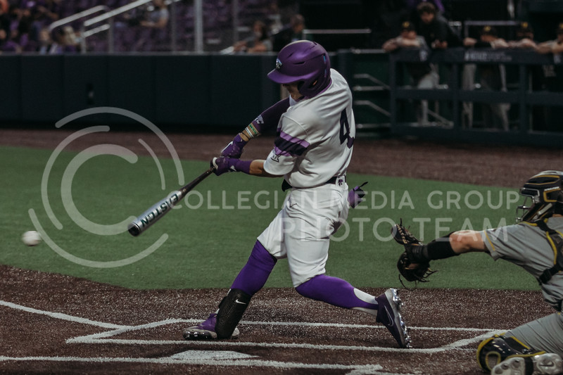 Sophomore Blake Burrows hits the ball during the April 27, 2021 game against Missouri at Tointon Family Stadium. (Sophie Osborn | Collegian Media Group)