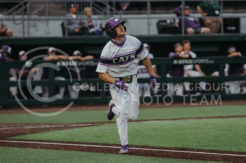 Senior Caleb Littlejim watches the ball he just hit during the April 27, 2021 game against Missouri at Tointon Family Stadium. (Sophie Osborn | Collegian Media Group)