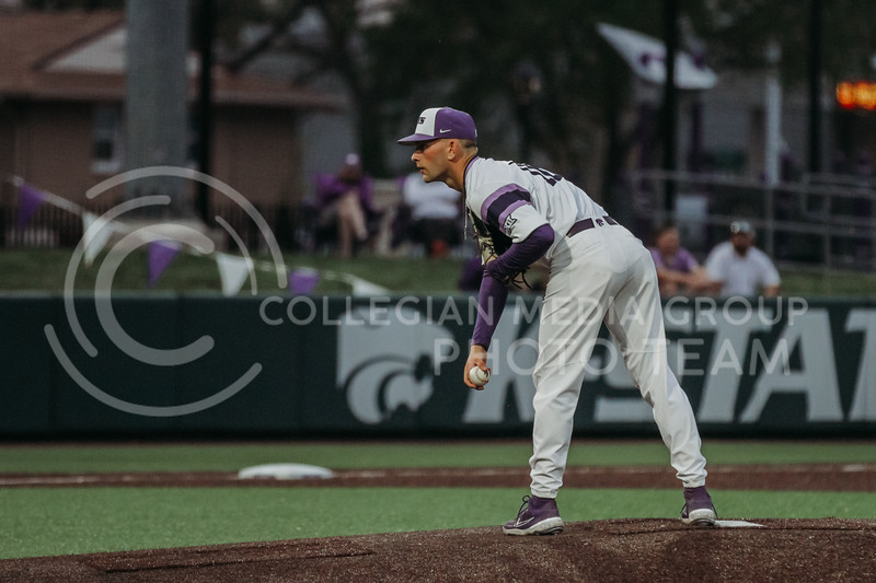 Freshman Elijah Dale looks at the batter before preparing to pitch during the April 27, 2021 game against Missouri at Tointon Family Stadium. (Sophie Osborn | Collegian Media Group)